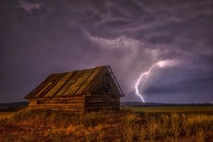 Lightening storm over an old barn