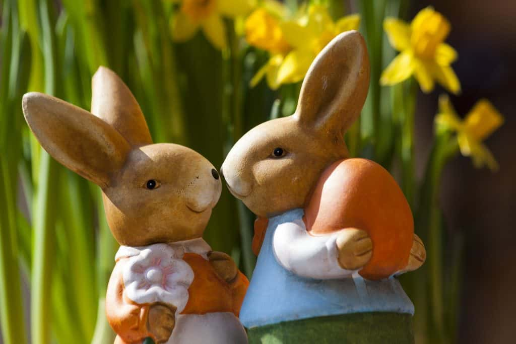 Porcelain Rabbits Holding Easter Egg