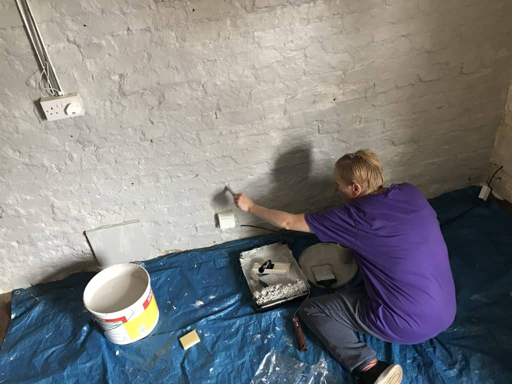 Painting the walls at Scruffies Salon