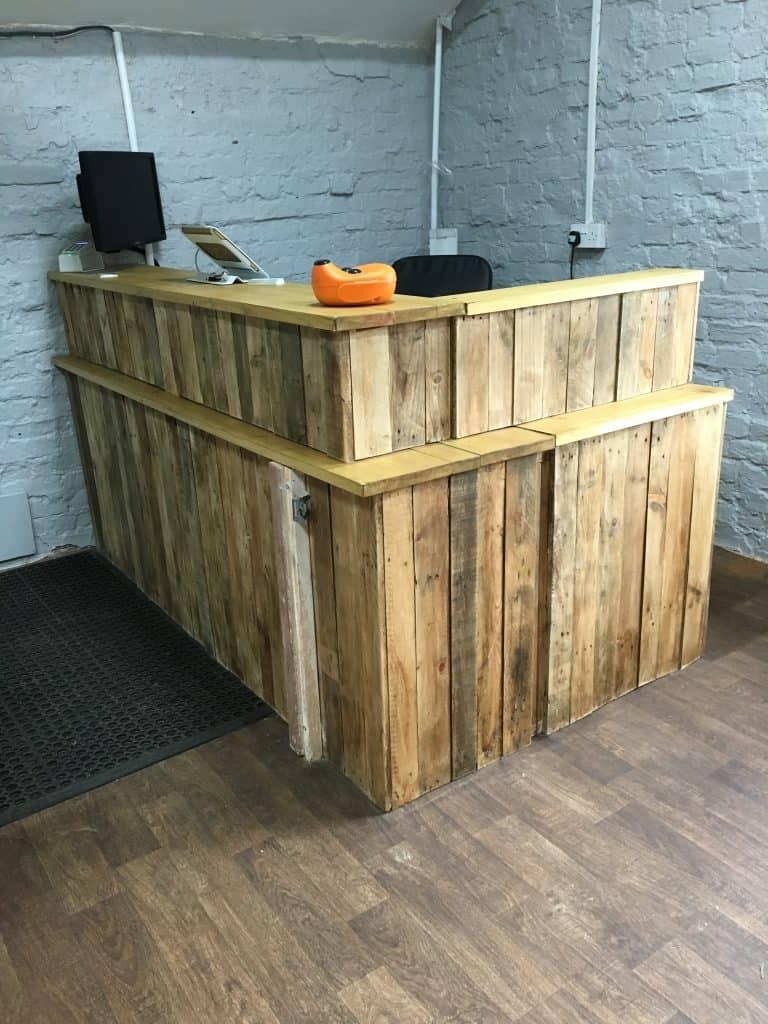 Scruffies reception desk profile view